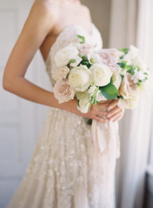 Classic bridal bouquet featuring a combination of garden roses, ranunculus and hellebores.