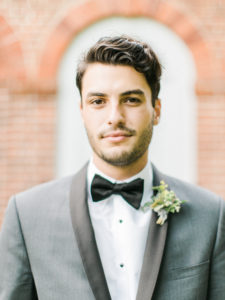 organic and masculine groom style with boutonniere