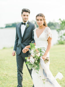 bride and groom portraits with bouquet at waterfront in Annapolis, Maryland