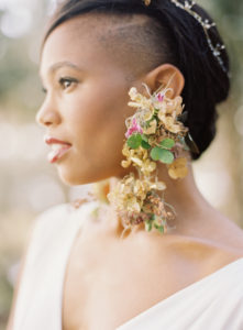 bold bridal style with statement floral earrings