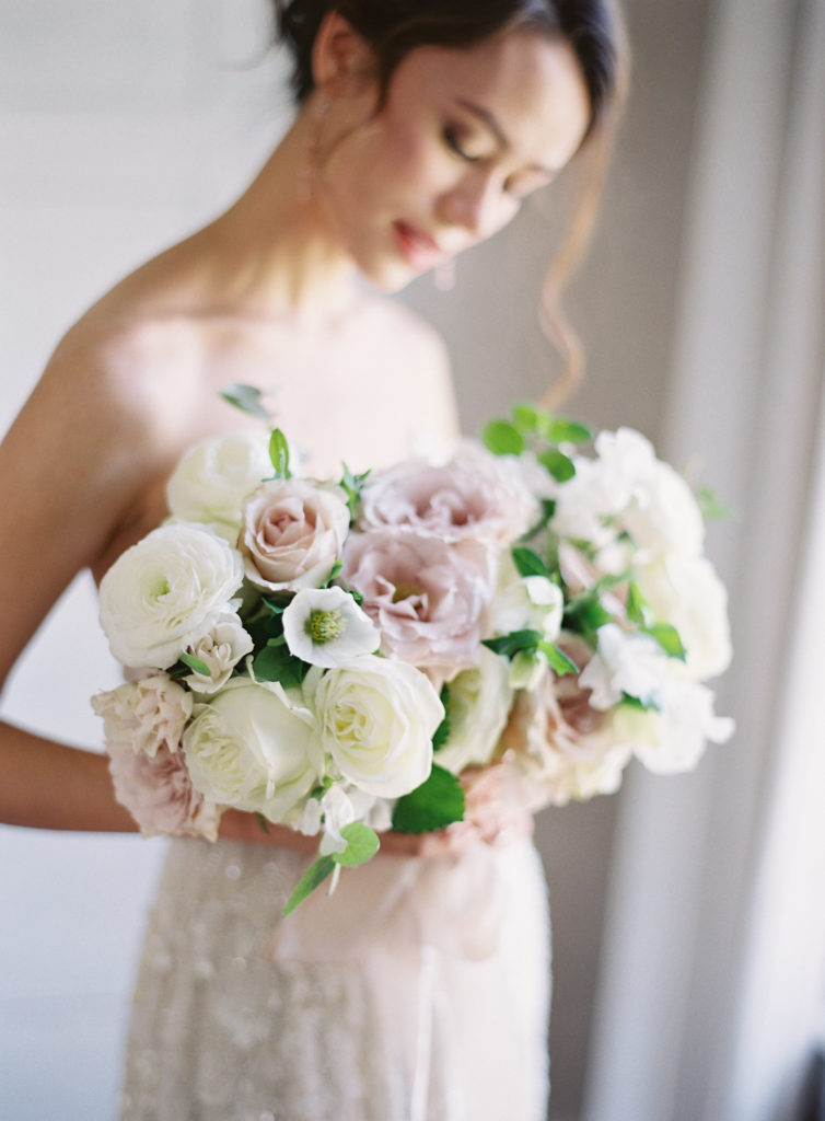 The Retreat at Cool Springs Michael and Carina Photography blush white roses ranunculus hellebore bride bouquet