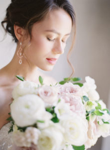 Bridal portrait with classic bridal bouquet in romantic light at The Retreat at Cool Springs