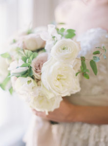 Bridal bouquet with lots of texture from lush garden roses, ranunculus and hellebores at The Retreat at Cool Springs