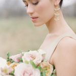 Bride with romantic gaze and organic florals