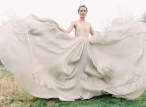 Tons of romantic movement in this bridal portrait from gorgeous Carroll Hannah dress