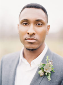 romantic organic and masculine groom style and boutonniere