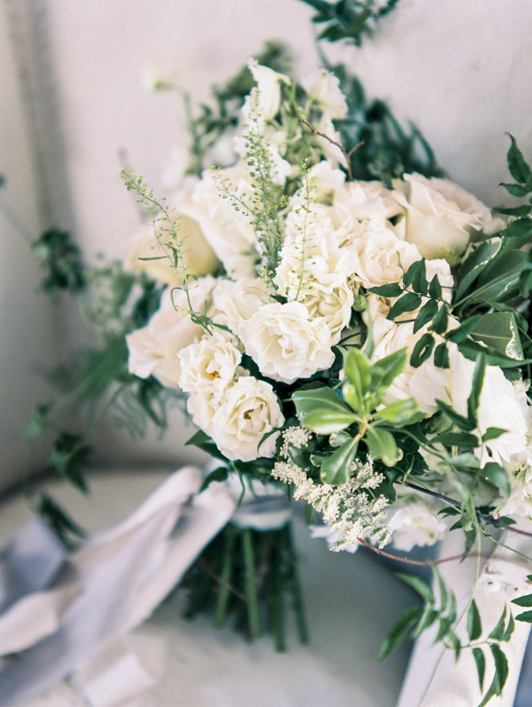 Elegant bridal bouquet with neutral tones of white, cream and green.