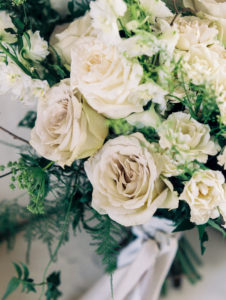 neutral toned bridal bouquet detail shot with roses and jasmine vines