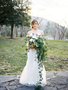 outdoor bridal portraits with large floral accent piece