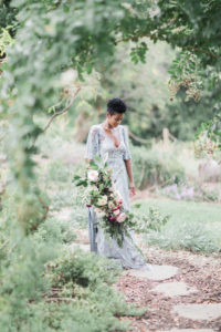 Bride with large bridal bouquet for summer garden wedding
