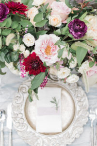 Place setting and centerpiece details for elopement inspiration in garden
