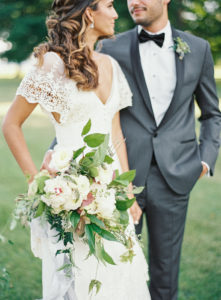 bride and groom portraits with wild and organic bridal bouquet
