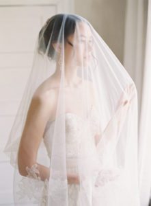 romantic indoor bridal portrait featuring a blusher veil at The Retreat at Cool Springs
