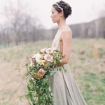 Romantic Organic modern bridal portrait featuring wild cascading bridal bouquet