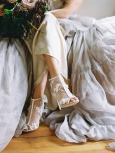 Bride with oversized bouquet and Bella Bella shoes