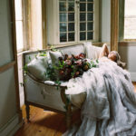 Romantic engagement with oversized organic bouquet and Carol Hannah gown