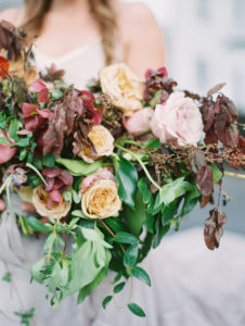 oversized bridal bouquet with garden roses, plum foliage, hellebore in pink gold and mauve
