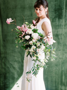 bride with cascading spring bouquet