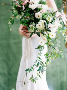 bridal bouquet with cascading greens and ranunculus