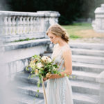 romantic portraits with bridal bouquet of garden roses and silk ribbon