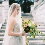 romantic and mysterious bridal portraits with organic wild bouquet with garden roses