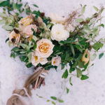 Bridal bouquet with organic greenery dried flowers and garden roses