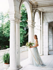 Bridal portraits in flowing gown with organic bouquet