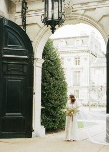 The Anderson House in Washington DC with bridal bouquet and veil for feminine luxe look and lush floral details