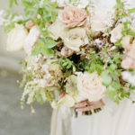 detail shot of lush textured spring bridal bouquet with feminine blooms