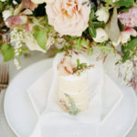 personal cakes act as escort card for each place setting with feminine luxe lush floral centerpiece