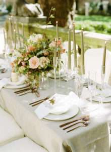 Neutral feminine tablescape with lush spring floral centerpiece and luxe details