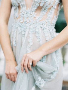 etherial feminism and bridal style with ring and textured gown