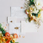 Parisian femininity wedding invitation suite with floral flat lay flowers