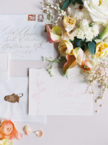 Parisian femininity floral flat lay with wedding invitation suite, calligraphy and wax seal