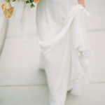 Parisian femininity bridal portrait with movement of gown and bouquet