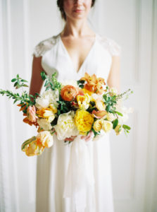 Parisian femininity oversized spring bouquet with elegant bridal gown