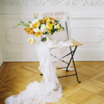 Parisian femininity bridal bouquet styling with lush spring blooms and veil