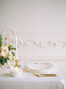 Parisian femininity wedding tablescape details with floral centerpiece and candles