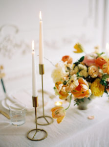 Parisian femininity wedding tablescape with vibrant spring floral arrangement