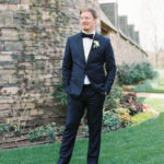 groom style for a modern black tie wedding with organic boutonniere