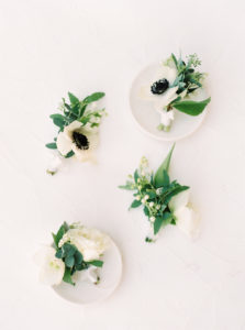 boutonnieres with anenomes for a moern black tie california wedding