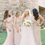 modern monochromatic bridal bouquet with neutral bridesmaids gowns