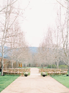 modern organic round wedding ceremony set up