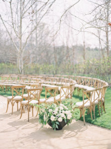 round ceremony set up with modern organic oversized ceremony arrangements